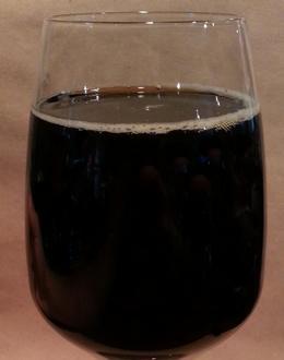 Бокал с осетинским пивом